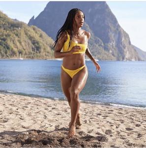 Crystal Dunn wearing Arrow + Phoenix Swim in Sports Ilustrated Swim